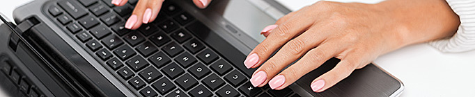 Woman typing on her laptop computer
